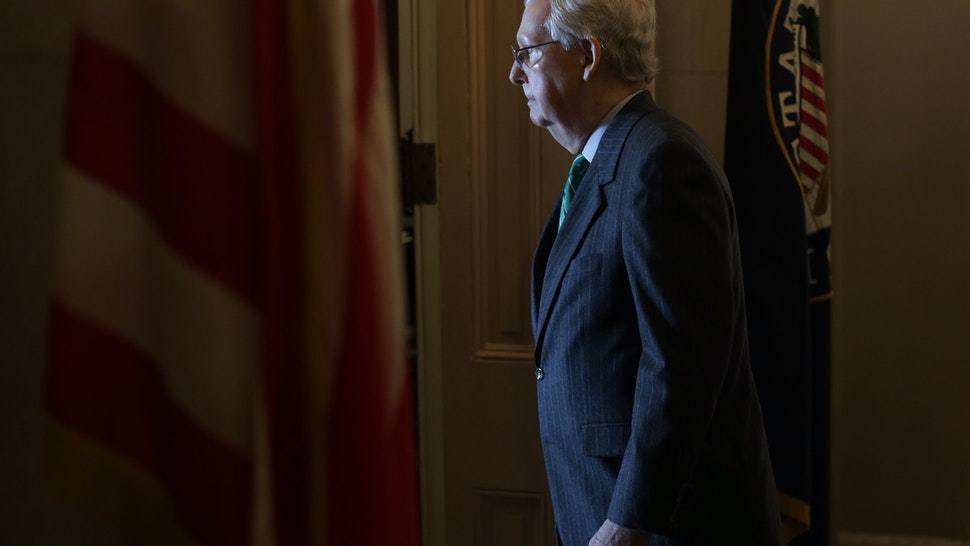"""WASHINGTON, DC - MARCH 19: U.S. Senate Majority Leader Sen. Mitch McConnell (R-KY) walks into his office after he spoke on the Senate floor at the U.S. Capitol March 19, 2020 on Capitol Hill in Washington, DC. The Senate is back in session today as GOPs and Democrats work behind the scenes to produce """"phase three"""" of the coronavirus response bill to combat the outbreak of the COVID-19 pandemic. (Photo by Alex Wong/Getty Images)"""
