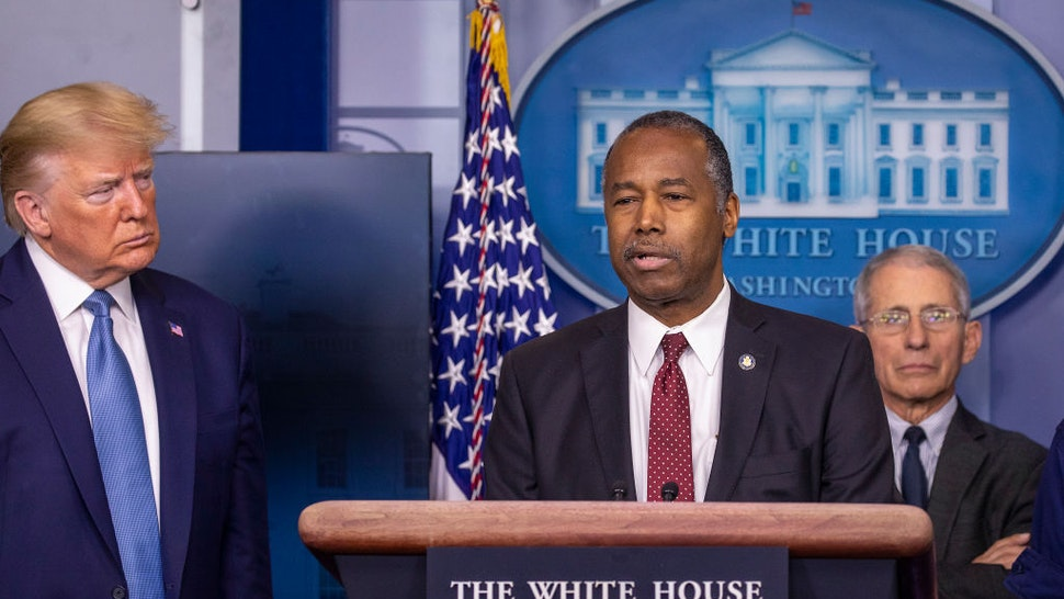 U.S. President Donald Trump listens to U.S. Housing and Urban Development Secretary Ben Carson speak during a briefing in the James Brady Press Briefing Room at the White House on March 21, 2020 in Washington, DC.