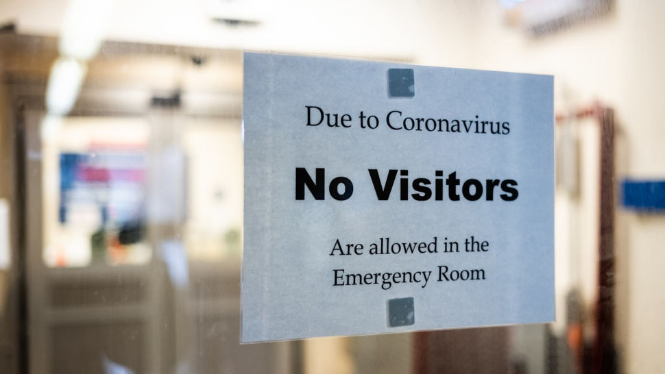 A sign is posted on the door of the Emergency Department at St. Barnabas Hospital on March 23, 2020 in the Bronx borough of New York City.