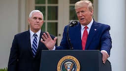 WASHINGTON, DC - MARCH 29: Vice President Mike Pence listens to U.S. President Donald Trump speak in the Rose Garden for the daily coronavirus briefing at the White House on March 29, 2020 in Washington, DC. The United States is advisingresidents of New York, New Jersey and Connecticutnot to travel domestically after the number of reportedcoronavirusdeaths doubled to over 2,000 nationwidewithin two days.
