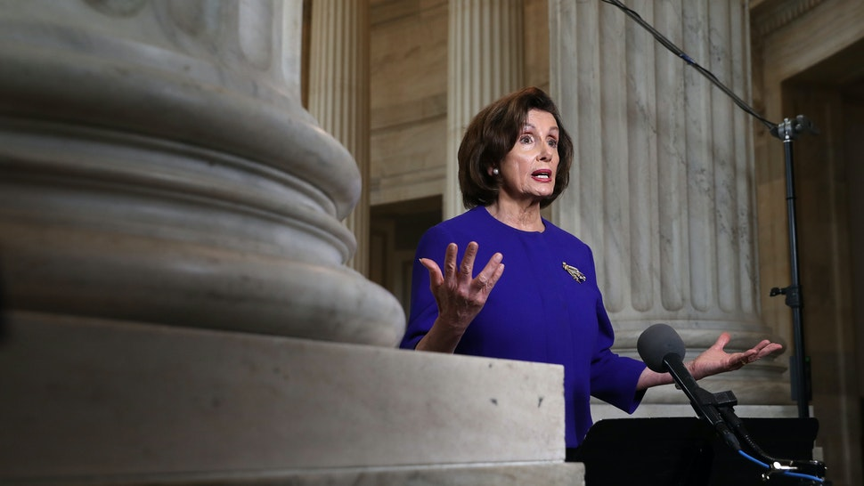"""WASHINGTON, DC - APRIL 01: U.S. Speaker of the House Nancy Pelosi (D-CA) is interviewed by CNN about the government response to the ongoing global coronavirus pandemic in the rotunda of the Russell Senate Office Building on Capitol Hill April 01, 2020 in Washington, DC. Pelosi told host Anderson Cooper that the federal government needs to give more financial help to state and local governments dealing with COVID-19. """"We had $150 billion in the bill that the President just signed. That is simply not enough, unfortunately,"""" she said. (Photo by Chip Somodevilla/Getty Images)"""