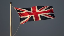A Union Jack flag flying against a dark sky on March 08, 2020 in Cardiff, United Kingdom.