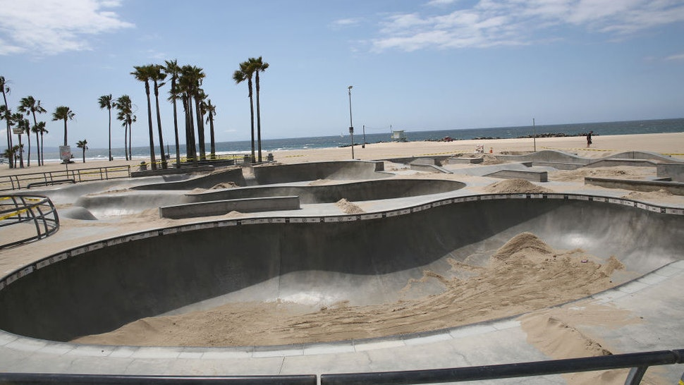 The Venice Beach skatepark is filled with sand to prevent people from using it during the coronavirus pandemic on April 18, 2020 in Venice, California. COVID-19 has spread to most countries around the world, claiming almost 159,000 lives and infecting over 2.3 million people.