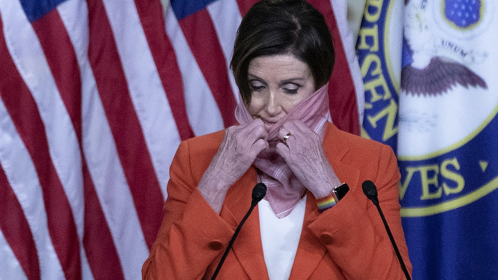 WASHINGTON, DC - APRIL 24: Speaker of the House Nancy Pelosi (D-CA) pulls down her scarf as she beings her weekly news conference during the novel coronavirus pandemic at the U.S. Capitol April 24, 2020 in Washington, DC. President Donald Trump is expected to sign a bipartisan $484 billion coronavirus relief package to restart a depleted small business loan program and to provide funds for hospitals and COVID-19 testing. (Photo by Chip Somodevilla/Getty Images)