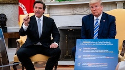 Florida Gov. Ron DeSantis (L) speaks while meeting with U.S. President Donald Trump in the Oval Office of the White House on April 28, 2020 in Washington, DC. Trump met with DeSantis to discuss ways that Florida is planning to gradually re-open the state in the wake of the COVID-19 pandemic.