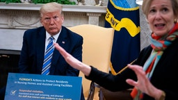 White House Coronavirus Task Force Coordinator Deborah Birx (R) answers a question while meeting with Florida Gov. Ron DeSantis and U.S. President Donald Trump in the Oval Office of the White House on April 28, 2020 in Washington, DC.