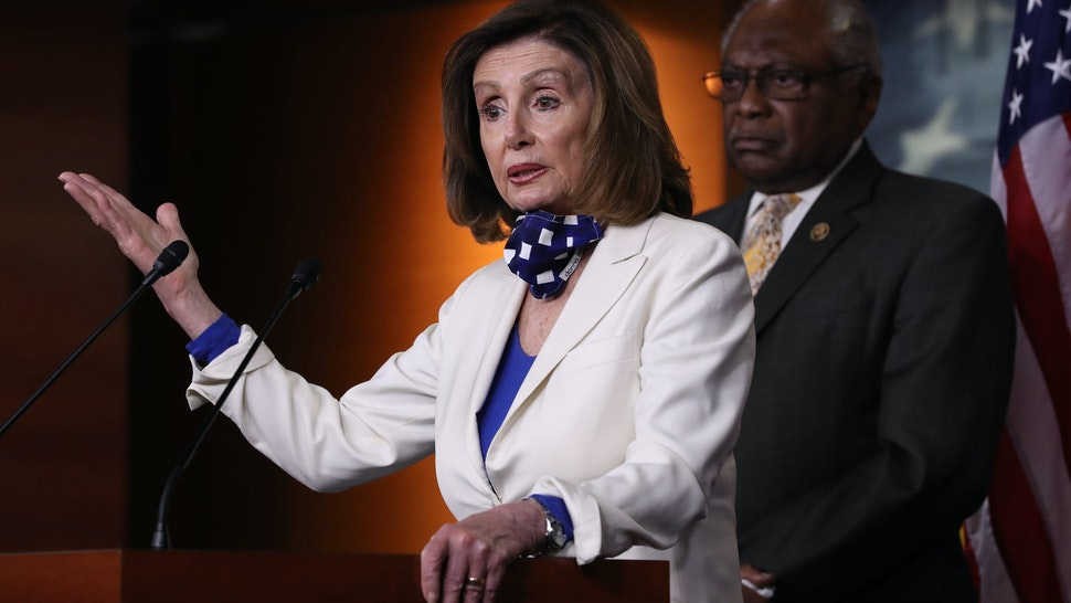 WASHINGTON, DC - APRIL 30: Speaker of the House Nancy Pelosi (D-CA) answers reporters' questions during her weekly news conference with House Majority Whip James Clyburn (D-SC) at the U.S. Capitol April 30, 2020 in Washington, DC. While she and Democratic House leaders are not going to reconvene next week due to the COVID-19 pandemic, she said committee chairs are working on the next piece of economic rescue legislation. (Photo by Chip Somodevilla/Getty Images)
