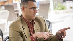 Omar Barghouti speaks to artists travelling with the 2014 Palestine Festival of Literature about the Boycott, Divestment and Sanctions (BDS) campaign against Israel on June 3, 2014 in Acre, Israel.