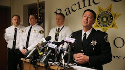 Racine County Sheriff Christopher Schmaling, right, announces, April 8, 2014 at a Racine County Sheriff patrol station in Sturtevant, Wis. the arrest in the 1997 murder of Amber Creek, 14, of Palatine.