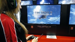 """PARIS, FRANCE - OCTOBER 28: A woman plays the video game """"Final Fantasy XV"""" developed and published by Square Enix during the """"Paris Games Week"""" on October 28, 2016 in Paris, France. """"Paris Games Week"""" is an international trade fair for video games to be held from October 27 to October 31, 2016. (Photo by Chesnot/Getty Images)"""