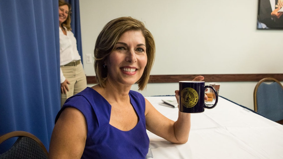 Former CBS News Correspondent Sharyl Attkisson, author of The Smear: How Shady Political Operatives and Fake News Control What You See, What You Think and How You Vote, holds up her National Press Club coffee mug, at the Club's Headliners Book Event in Washington, D.C., on Thursday, August 31, 2017.