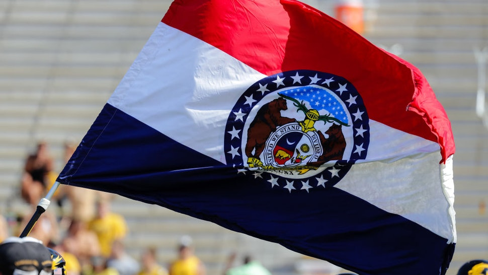 The State Flag of Missouri leads the Missouri Tigers' onto the field prior to the start of the first half of the Purdue Boilermakers game at the Missouri Tigers on September 16, 2017, at Memorial Stadium on Faurot Field in Columbia, MO.