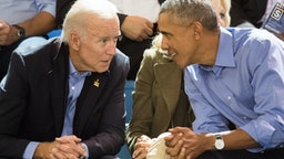 TORONTO, ON - SEPTEMBER 29: Joe Biden and Barack Obama watch the wheelchair basketball on day 7 of the Invictus Games Toronto 2017 on September 29, 2017 in Toronto, Canada. The Games use the power of sport to inspire recovery, support rehabilitation and generate a wider understanding and respect for the Armed Forces. (Photo by Samir Hussein/Samir Hussein/WireImage)