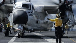 "TLANTIC OCEAN, OCTOBER 20: In this U.S. Navy handout, aviation Boatswain's Mate (Handling) 1st Class Michael Osborne directs a C-2A Greyhound, assigned to the ""Rawhides"" of Fleet Logistics Support Squadron (VRC) 40, on the flight deck aboard USS Harry S. Truman (CVN 75) on October 20, 2017 in the Atlantic Ocean. Truman is currently underway conducting Tailored Shipboard Test Availability and Final Evaluation Problem (TSTA/FEP) in preparation for future operations. (Photo by Mass Communication Specialist 2nd Class Anthony Flynn/U.S. Navy via Getty Images)TLANTIC OCEAN, OCTOBER 20: In this U.S. Navy handout, aviation Boatswain's Mate (Handling) 1st Class Michael Osborne directs a C-2A Greyhound, assigned to the ""Rawhides"" of Fleet Logistics Support Squadron (VRC) 40, on the flight deck aboard USS Harry S. Truman (CVN 75) on October 20, 2017 in the Atlantic Ocean. Truman is currently underway conducting Tailored Shipboard Test Availability and Final Evaluation Problem (TSTA/FEP) in preparation for future operations. (Photo by Mass Communication Specialist 2nd Class Anthony Flynn/U.S. Navy via Getty Images)"