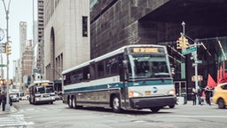 Public transportation buses on Fifth Avenue , Midtown Manhattan, Midtown Manhattan .