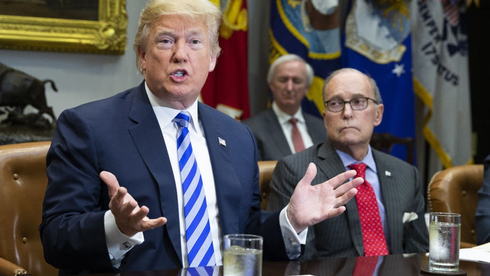 U.S. President Donald Trump speaks while Larry Kudlow, director of the U.S. National Economic Council, right, listens during a meeting with automotive executives in the Roosevelt Room of the White House in Washington, D.C., U.S., on Friday, May 11, 2018.