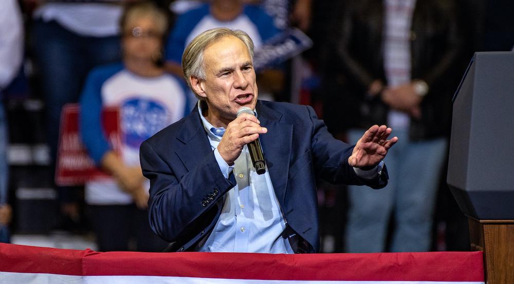Greg Abbott, thống đốc bang Texas, phát biểu trong một cuộc vận động tranh cử ngày 22 tháng 10 năm 2018. Nhiếp ảnh gia: Sergio Flores / Bloomberg