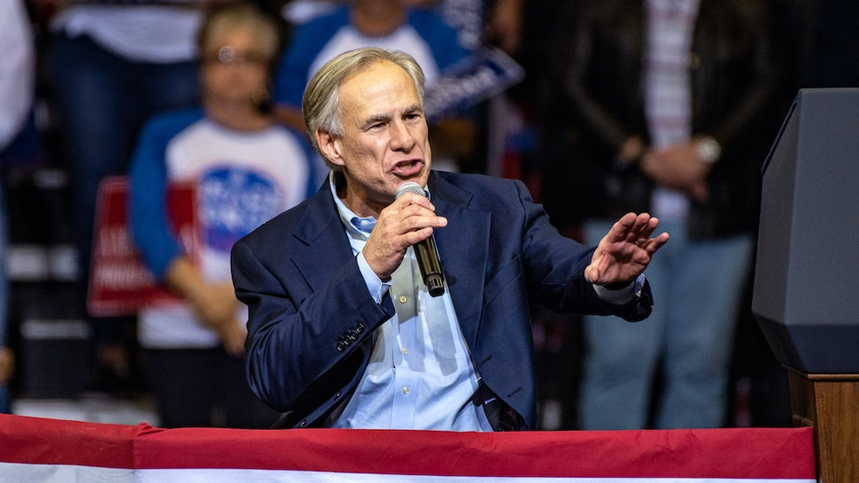 "Greg Abbott, governor of Texas, speaks during a campaign rally with U.S. President Donald Trump for Senator Ted Cruz, not pictured, in Houston, Texas, U.S., on Monday, Oct. 22, 2018. Trump declared that he's a ""nationalist"" at the rally as he appealed to Texas Republicans to re-elect Cruz and help the party keep control of Congress. Photographer: Sergio Flores/Bloomberg"