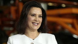 Gretchen Whitmer, governor of Michigan, smiles during an event at the General Motors Co. Orion Assembly plant in Orion Township, Michigan, U.S., on Friday, March 22, 2019. General Motors Co.committed to investing $1.8 billion at plants in six states and to creating 700 new jobs, as the largest U.S. automaker looks to ward offmonths of criticismby PresidentDonald Trump.