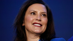 HAMTRAMCK, MI - JANUARY 27: Michigan Gov. Gretchen Whitmer stands on stage at an event where General Motors announced that GMs Detroit-Hamtramck Assembly plant will build the all-electric Cruise Origin self-driving shuttle on January 27, 2020 in Hamtramck, Michigan. GM will invest $2.2 billion at the Detroit-Hamtramck plant and 2200 jobs for an all-electric future for electric pickups, SUVs, and autonomous vehicles.