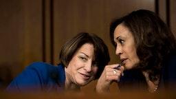 WASHINGTON, DC - Senators Amy Klobuchar (D-MN) and Kamala Harris (D-CA) speak quietly during the Supreme Court nominee Brett Kavanaugh's confirmation hearing in the Senate Judiciary Committee on Capitol Hill in Washington, DC on Wednesday September 5, 2018.