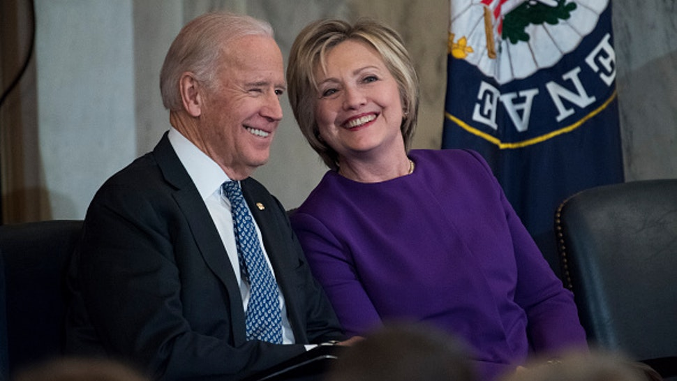 UNITED STATES - DECEMBER 08: Vice President Joe Biden and former Secretary of State Hillary Clinton attend a portrait unveiling ceremony for retiring Senate Minority Leader Harry Reid, D-Nev., in Russell Building's Kennedy Caucus Room, December 08, 2016.