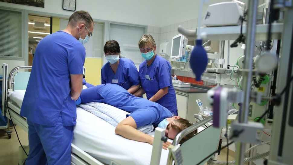 Nurse Carla Stuermer (3rd L) coaches medical staff how to reposition Covid-19 patients in the intensive care unit of the community hospital in Magdeburg, eastern Germany, on April 16, 2020 during the novel coronavirus COVID-19 pandemic. (Photo by Ronny Hartmann / AFP) (Photo by RONNY HARTMANN/AFP via Getty Images)