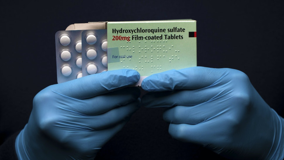 """LONDON, UNITED KINGDOM - MARCH 26: In this photo illustration a pack of Hydroxychloroquine Sulfate medication is held up on March 26, 2020 in London, United Kingdom. The Coronavirus (COVID-19) pandemic has spread to many countries across the world, claiming over 20,000 lives and infecting hundreds of thousands more. U.S. President Donald Trump recently promoted Hydroxychloroquine, a common anti-malaria drug, as a potential treatment for COVID-19 when combined with the antibiotic azithromycin. """"HYDROXYCHLOROQUINE & AZITHROMYCIN, taken together, have a real chance to be one of the biggest game changers in the history of medicine,"""" President Trump tweeted last week."""