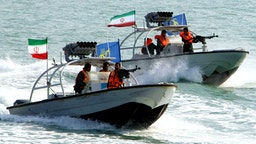 "(COMBO) This combination of file pictures created on July 22, 2019 shows Iranian Revolutionary Guards driving speedboats at the port of Bandar Abbas on July 02, 2012 (L), and the amphibious assault ship USS Boxer (LHD 4) as transiting the East Sea during exercises on March 7, 2016. - Iran's seizure of a British-flagged oil tanker in the Strait of Hormuz was a ""legal measure"", the spokesman for the Islamic republic's government said on July 22. Iran impounded the Stena Impero tanker on allegations it failed to respond to distress calls and turned off its transponder after hitting a fishing boat. (Photos by Atta KENARE and Craig Z. Rodarte / various sources / AFP) / RESTRICTED TO EDITORIAL USE - MANDATORY CREDIT ""AFP PHOTO /US NAVY/GREG Z RODARTE"" - NO MARKETING NO ADVERTISING CAMPAIGNS - DISTRIBUTED AS A SERVICE TO CLIENTS"