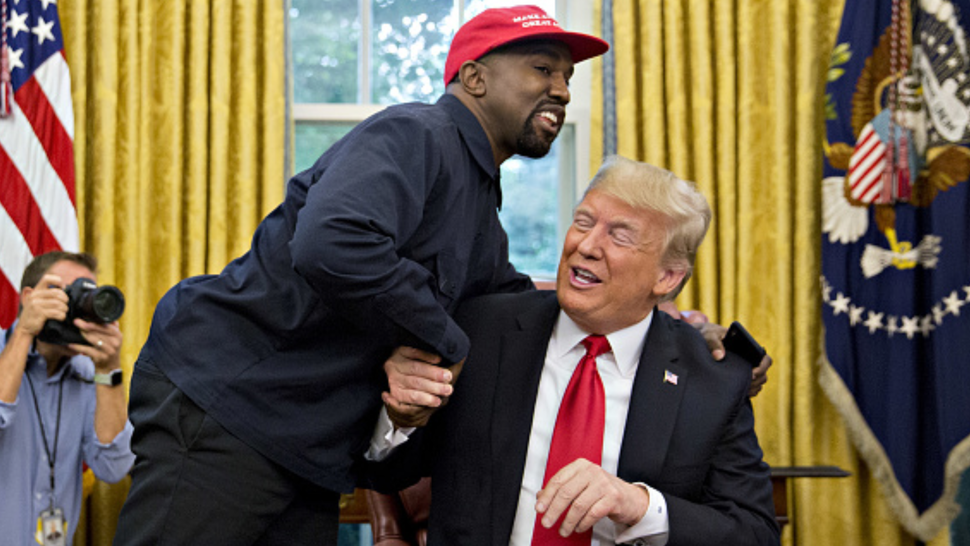 Rapper Kanye West, left, shakes hands with U.S. President Donald Trump during a meeting in the Oval Office of the White House in Washington, D.C., U.S., on Thursday, Oct. 11, 2018. West, a recording artist and prominent Trump supporter, is at the White House to have lunch with the president and to meet with presidential son-in-law and senior adviser Jared Kushner who has spearheaded the administrations efforts overhaul the criminal justice system.