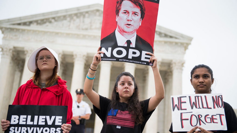 Protesters demonstrate in front of the Supreme Court to oppose the new associate justice Brett Kavanaugh on his first day of hearing arguments on October 4, 2018. (Photo By Tom Williams/CQ Roll Call)