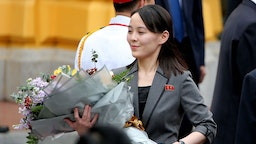 Kim Yo Jong, sister of North Korean leader Kim Jong Un, holds a flower bouquet during a welcoming ceremony at the Presidential Palace in Hanoi, Vietnam, on Friday, March 1, 2019. Kim will have a long train ride home through China to think about what went wrong in his second summit with Donald Trump and how to keep it from reversing his gains of the past year. Photographer: Luong Thai Linh/Pool via Bloomberg