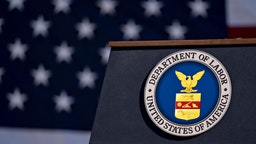 The U.S. Department of Labor seal hangs on a podium outside the headquarters in Washington, D.C., U.S., on Thursday, Aug. 29, 2019. U.S. economic growth decelerated in the second quarter by more than initially reported, suggesting President Donald Trump's trade actions are weighing more heavily on the pace of expansion. Photographer: Andrew Harrer/Bloomberg