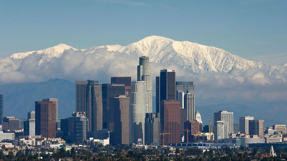 LOS ANGELES, CA - JANUARY 7: Fresh snow blankets the mountains behind the downtown skyline after a series of storms that hammered northern California delivered much needed precipitation to the Greater Los Angeles Area January 7, 2008 in Los Angeles, California. With the threat of mandatory water rationing still in effect because of prolonged drought, the rain is a small step toward relief. Forecasters had predicted flash floods and mudslides near large areas that were denuded by wildfires of historic proportions in October, and some mandatory evacuations were declared, but little damage was reported.