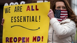 ANNAPOLIS, MD - APRIL 18: Protesters with the group Reopen Maryland rally near the State House to call on the state to lift the stay-at-home order and reopen the economy on April 18, 2020 in Annapolis, Maryland. Most protestors rallied from inside their cars as they caused gridlock in a traffic circle and a smaller group protested outside of their cars. (Photo by Drew Angerer/Getty Images)