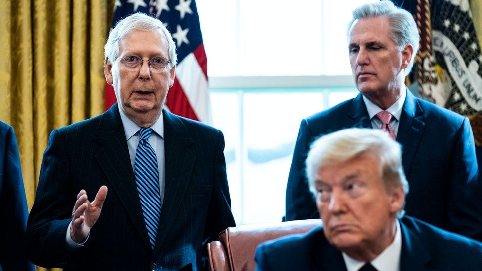 WASHINGTON, DC - MARCH 27: (L-R) Senate Majority Leader Mitch McConnell (R-KY) speaks as House Minority Leader Kevin McCarthy (R-CA) U.S. President Donald Trump listen during a signing ceremony for H.R. 748, the CARES Act in the Oval Office of the White House on March 27, 2020 in Washington, DC. Earlier on Friday, the U.S. House of Representatives approved the $2 trillion stimulus bill that lawmakers hope will battle the the economic effects of the COVID-19 pandemic.