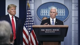 """U.S. Vice President Mike Pence speaks as President Donald Trump, left, and Larry Kudlow, director of the U.S. National Economic Council, right, listen during a Coronavirus Task Force news conference in the briefing room of the White House in Washington, D.C., U.S., on Tuesday, March 24, 2020. Trumpsaid he envisions """"packed"""" U.S. churches on Easter Sunday as he described his ambition to abandon stringent public-health measures to combat the coronavirus outbreak and re-open the economy in mid-April. Photographer: Oliver Contreras/SIPA/Bloomberg"""