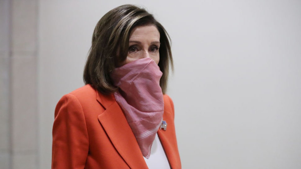 Speaker of the House Nancy Pelosi (D-CA) wears a scarf over her mouth and nose as she arrives for her weekly news conference during the novel coronavirus pandemic at the U.S. Capitol April 24, 2020 in Washington, DC. President Donald Trump is expected to sign a bipartisan $484 billion coronavirus relief package to restart a depleted small business loan program and to provide funds for hospitals and COVID-19 testing. (Photo by Chip Somodevilla/Getty Images)
