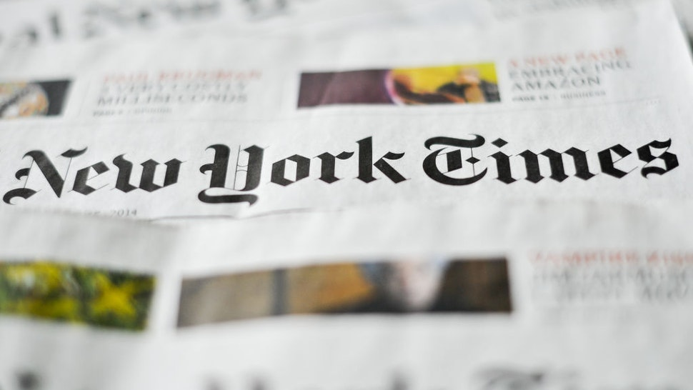 ILLUSTRATION - Various editions of the New York Times newspaper are on display on a table in Berlin, Germany, 23 April 2014. Photo: Ole Spata/dpa | usage worldwide (Photo by Ole Spata/picture alliance via Getty Images)