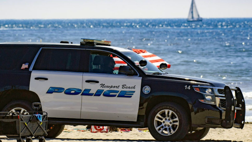 NEWPORT BEACH, CA - APRIL 25: Newport Beach Police patrol near the pier as thousands enjoy a day at the beach on Saturday, April 25, 2020.