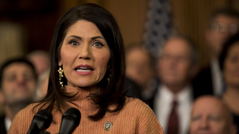 Representative Kristi Noem, a Republican from South Dakota, speaks during a Tax Cuts and Jobs Act enrollment ceremony at the U.S. Capitol in Washington, D.C., U.S., on Thursday, Dec. 21, 2017. Republicans want to channel momentum from the GOP's victory on taxes into a push to overhaul the nation's welfare programs, though some of PresidentDonald Trump's advisers prefer a less controversial infrastructure plan at the top of his agenda.