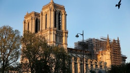 Notre-Dame cathedral is seen at sunset after repair work stops due to the coronavirus (COVID 19) outbreak one year after fire ravaged the emblematic monument as the coronavirus lockdown continues on April 14, 2020 in Paris, France. April 15 marks the first anniversary of the fire at Notre Dame destroying many parts of the Gothic cathedral. The Coronavirus (COVID-19) pandemic has spread to many countries across the world, claiming over 125,000 lives and infecting over 1.9 million people. (Photo by Chesnot/Getty Images)