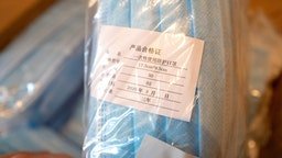 Close-up of a cardboard box filled with packaged blue surgical masks imported from China during an outbreak of the COVID-19 coronavirus in San Ramon, California, April 5, 2020.