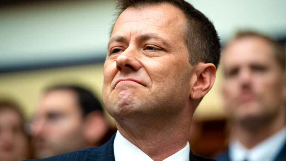 Deputy Assistant FBI Director Peter Strzok testifies on FBI and Department of Justice actions during the 2016 Presidential election during a House Joint committee hearing on Capitol Hill in Washington, DC, July 12, 2018. - An FBI agent assailed as biased by Donald Trump after it emerged he railed against the president in private messages with his lover, said Thursday such attacks are bolstering Russia's Vladimir Putin and tearing the United States apart. Ahead of a congressional hearing on alleged anti-Trump bias in the Federal Bureau of Investigation, Peter Strzok denied assertions that the investigation into Russian meddling in the 2016 election was a politicized probe targeting the president.