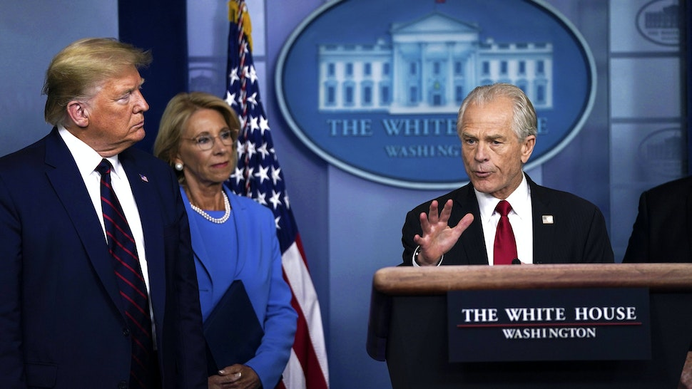 WASHINGTON, DC - MARCH 27: White House Trade and Manufacturing Policy Director Peter Navarro speaks as U.S. President Donald Trump and Secretary of Education Betsy DeVos during a briefing on the coronavirus pandemic in the press briefing room of the White House on March 27, 2020 in Washington, DC. President Trump signed the H.R. 748, the CARES Act on Friday afternoon. Earlier in the day, the U.S. House of Representatives approved the $2 trillion stimulus bill that lawmakers hope will battle the economic effects of the COVID-19 pandemic.