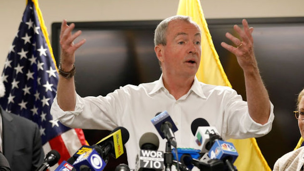 New Jersey Governor Phil Murphy speaks about Newark's ongoing water crisis during a press conference held at the Newark Health Department on August 14, 2019 in Newark, New Jersey. The city recently began distributing bottled water to residents affected by tap water that's been contaminated with lead in certain areas of the city. At left are Newark Mayor Ras Baraka and Kareem Addem, acting director of Water and Sewer Utilities in Newark. At right is Judy Persichilli, acting Judy Persichilli as Commissioner of the New Jersey Department of Health. (Photo by Rick Loomis/Getty Images)