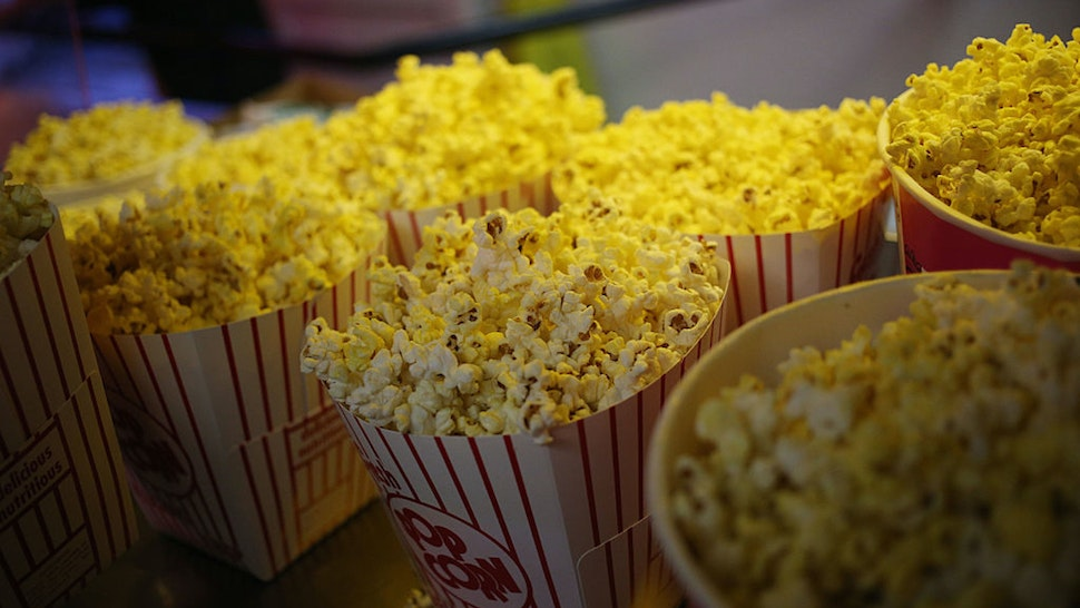Freshly popped popcorn is displayed for sale inside the snack bar at the Georgetown Drive-In movie theater in Georgetown, Indiana, U.S., on Friday, July 17, 2015. The Georgetown Drive-In opened in 1951 and has been family-owned and operated for the past fifty years.