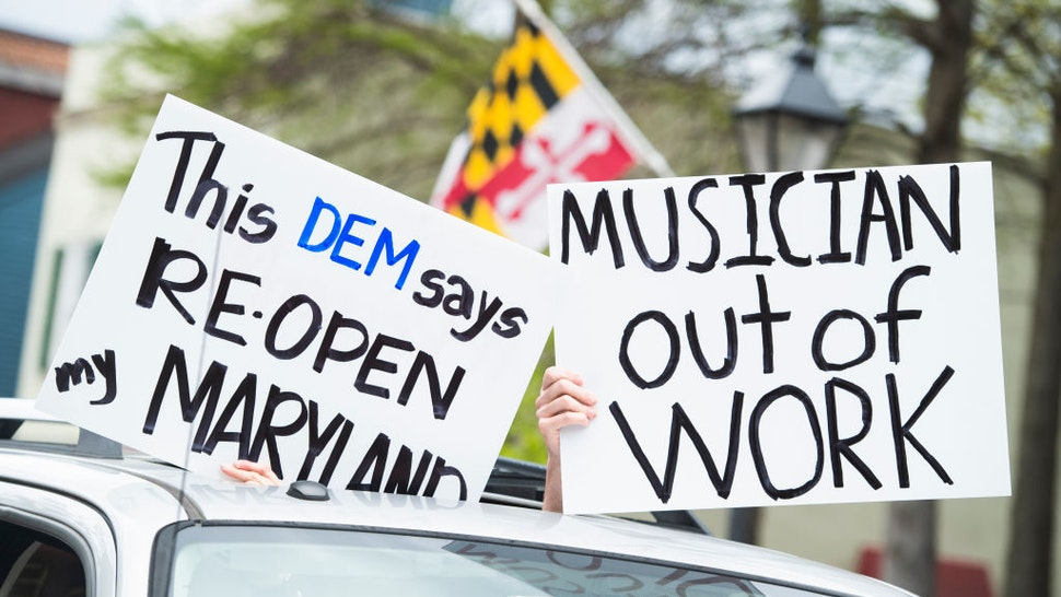 Demonstrators demand that Gov. Larry Hogan (R) lift restrictions that have closed certain businesses in Maryland since the coronavirus outbreak on Church Circle in Annapolis, Md., on Saturday, April 18, 2020. The event titled Operation Gridlock Annapolis was hosted by the Patriot Picket and Reopen Maryland. (Photo By Tom Williams/CQ-Roll Call, Inc via Getty Images)