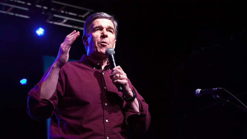 North Carolina gubernatorial candidate Roy Cooper speaks during Get Out the Vote at The Fillmore Charlotte on November 6, 2016 in Charlotte, North Carolina. (Photo by Jeff Hahne/Getty Images)