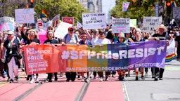 SAN FRANCISCO, CALIFORNIA - JUNE 30: Parade participants walk for a cause during the San Francisco Gay Pride parade on June 30, 2019 in San Francisco, California